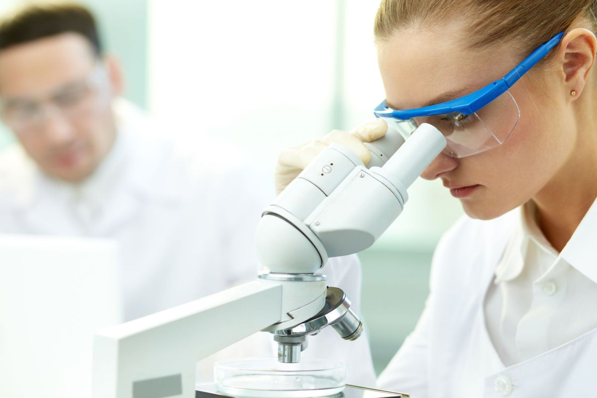 serious clinician studying chemical element in laboratory - clinical research recruitment firms