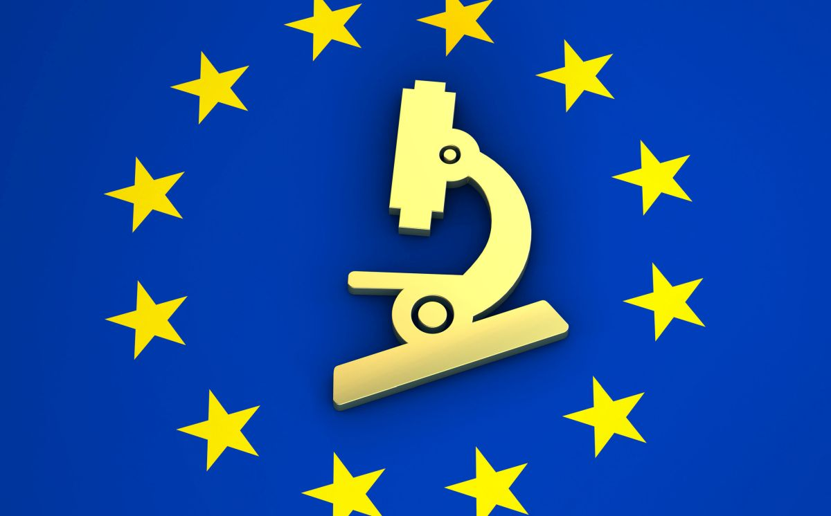 Research, science and medical system in Europe concept with EU flag and microscope icon symbol representing the regulatory submission process