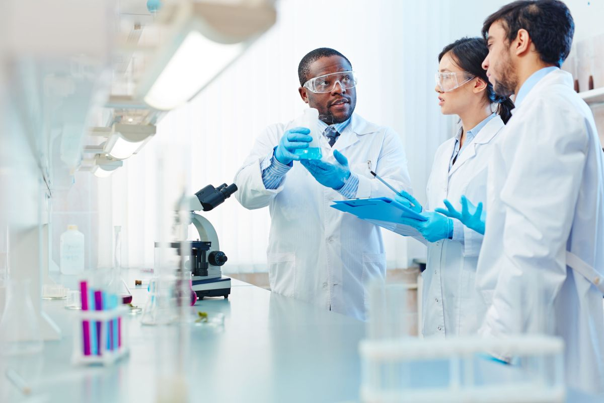 Scientists Discussing Chemical Reaction - clinical research recruitment firms