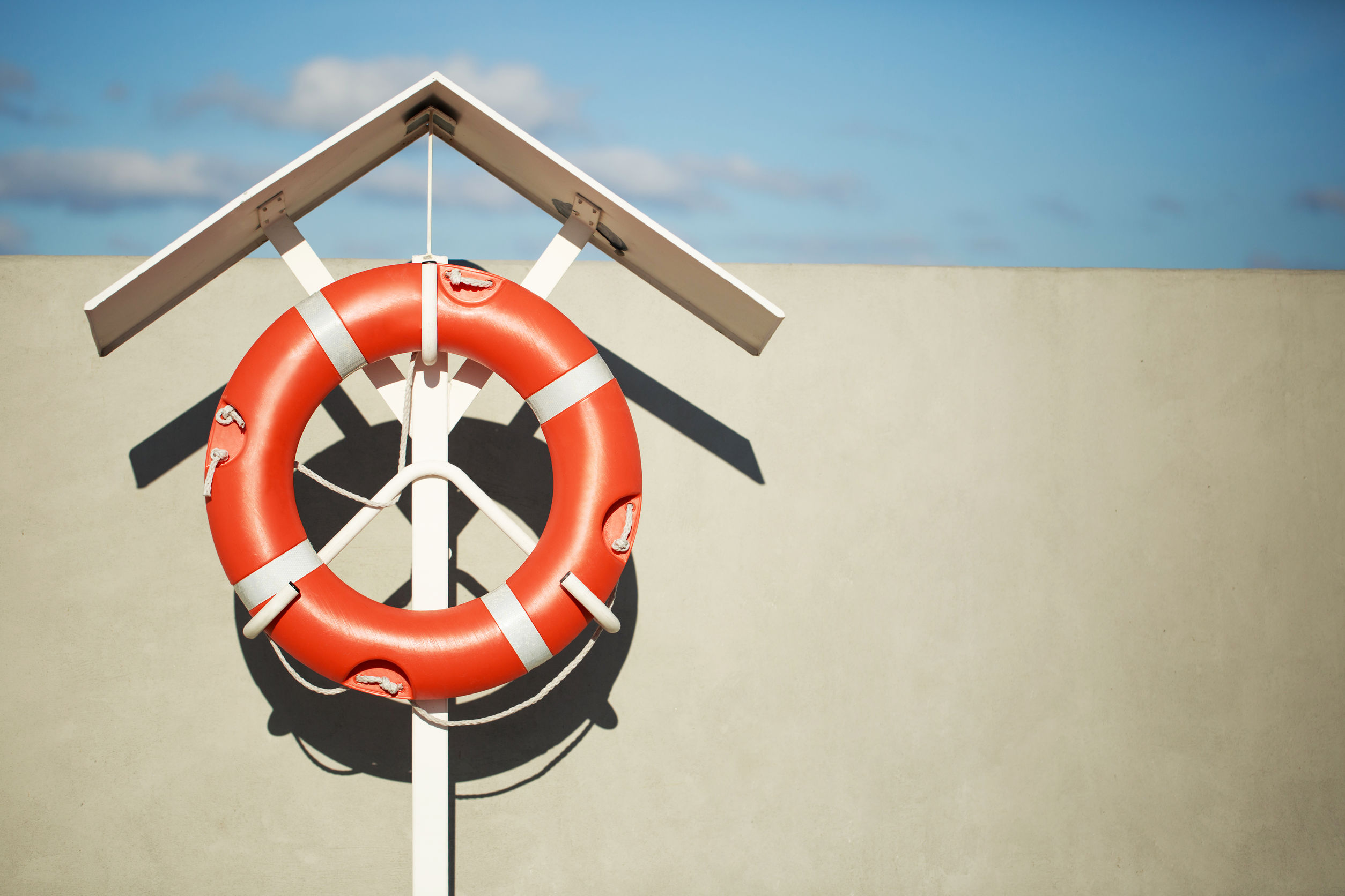 Lifebuoy on the pier with blue sky background - time management
