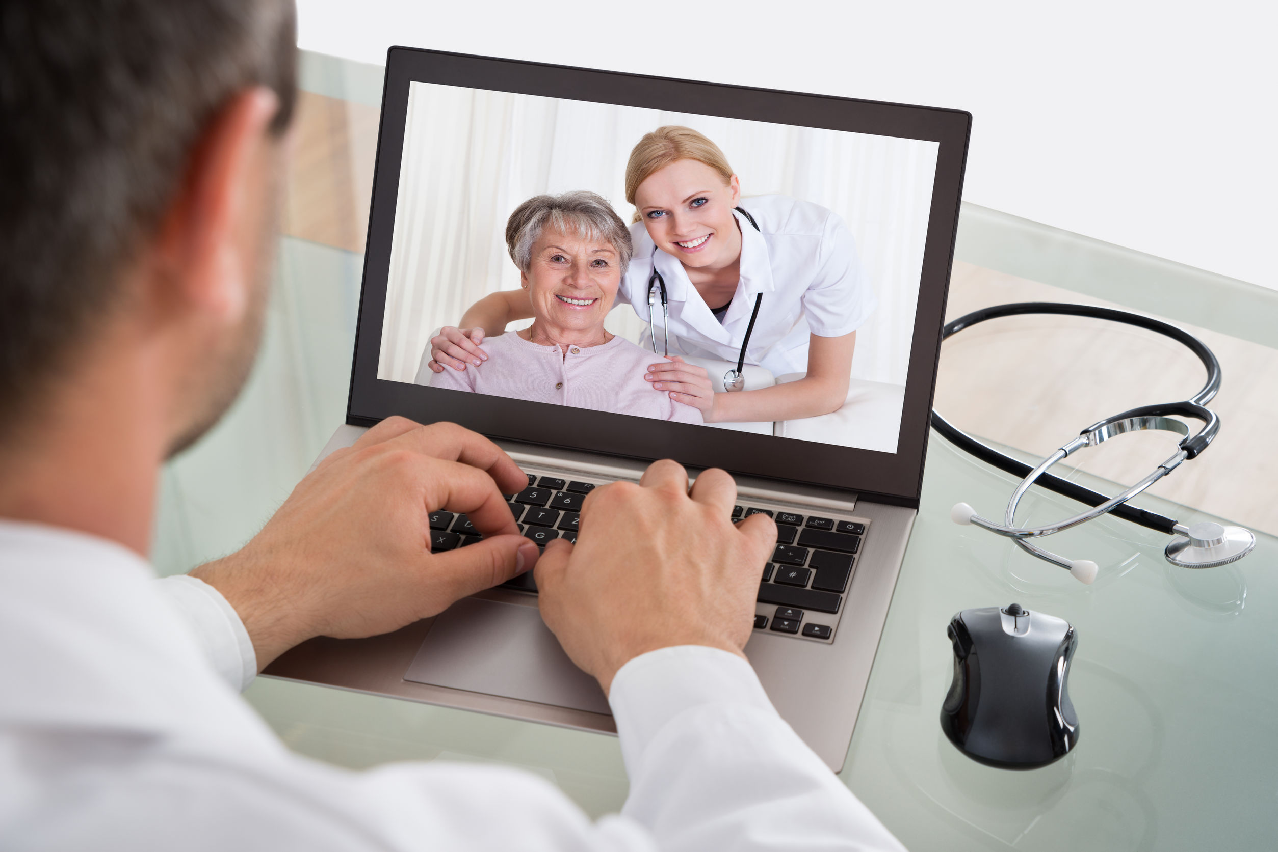 doctor having video conference with senior patient and nurse - virtual clinical trials